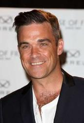 Listen to Robbie Williams She's The One song online from Amorous songs collection for free.