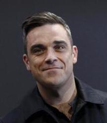 Besides Luis Fonsi music, we recommend you to listen online Robbie Williams songs.