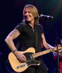 Listen to a new Keith Urban song Coming Home for free.