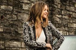 Listen to a new Maren Morris  song Rich for free.